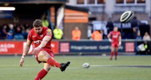 Scarlets' Leigh Halfpenny:   along with Johnny McNicholl he pulled up lame during the captain's run. Photograph:  Ian Cook/Inpho