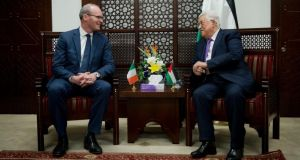 Tánaiste Simon Coveney and Palestinian president Mahmoud Abbas at the president's office in the West Bank city of Ramallah. Photograph: Majdi Mohammed/AP