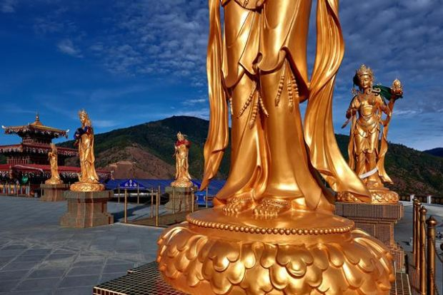 Buddhist statues in Thimphu, Bhutan. Photograph: New York Times