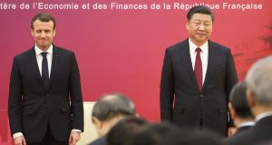 Emmanuel Macron and Chinese president Xi Jinping stand to inaugurate the first meeting of the French-Chinese business council, in Beijing this week. Photograph: Ludovic Marin/Reuters
