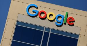 The Google logo is pictured atop a Californian building: Pornographic images have been found in children's games in the Google Play Store. Photograph: Mike Blake / Reuters