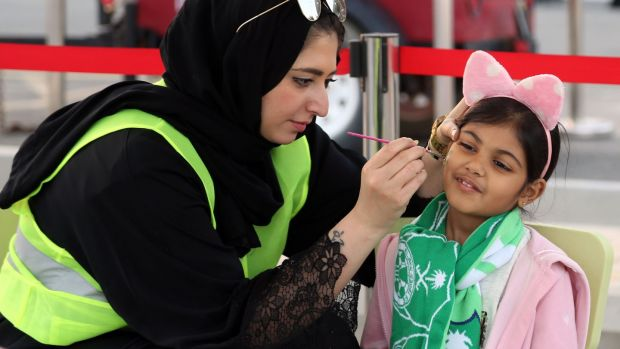 A young girl has her face painted ahead of the Saudi Pro League match between Al-Ahli and Al-Batin. Photograph: AFP