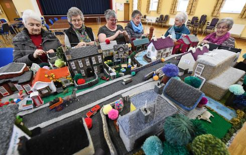 VILLAGE PEOPLE: Ladies from Cloughmills Crochet Club put the finishing touches to their painstaking wool recreation of the Co Antrim village. Photograph: Justin Kernoghan