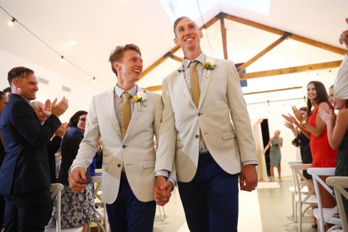 LOVE WINS: Craig Burns and Luke Sullivan during their wedding ceremony at Summergrove Estate in the Gold Coast, Australia. Photograph: Chris Hyde/Getty Images