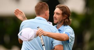 Henrik Stenson and Tommy Fleetwood after winning their foursomes match on day two of the EurAsia Cup. Photograph: Stuart Franklin/Getty