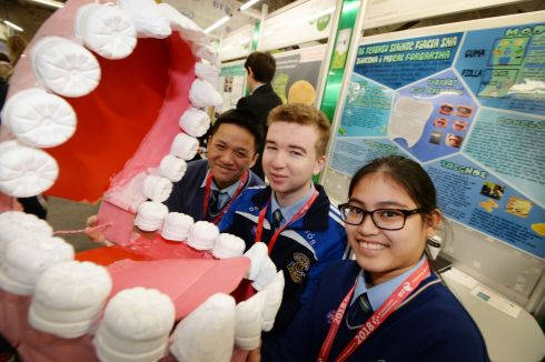 Zhi Jie Chen, Shay Slavin and Destiny Burdeos from Gaelcholáiste Mhuire, Cork, with their project 'Denta Solve' at the RDS. Photograph: Alan Betson/The Irish Times