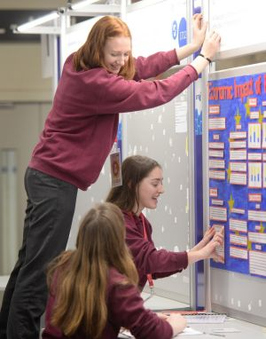 Hollie Collins, Tarah Fleming and Aoife Nash, Schull Community College, Cork, set up their project on the impact of 'Brexit' on the Irish generation Z. Photograph: Dara Mac Donaill/The Irish Times