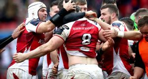 Ulster's Nick Timoney is congratulated after scoring his try. Photograph: Ryan Byrne/Inpho