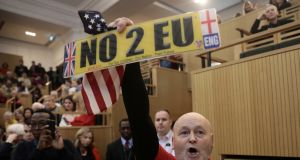A demonstrator holds a pro-Brexit sign and a US flag, as the speech by the Mayor of London, Sadiq Khan, is interrupted. Photograph: Simon Dawson/Reuters