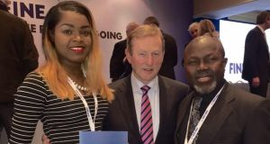 Michaella Itaire and her father Michael  pictured with former taoiseach Enda Kenny. The pair say they were refused entry onto their flight from Ghana back to Europe due to luggage issues.