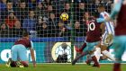 Manuel Lanzini scores West Ham's fourth aganist Huddersfield. Photograph: Martin Rickett/PA