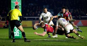 James Chisholm of Harlequins scores the winning try against Wasps at the Stoop. Photograph:  Henry Browne/Getty Images