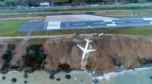 Passenger plane stuck on cliff edge after skidding off runway in Turkey
