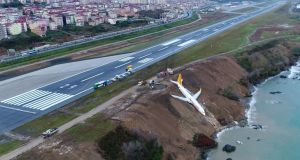 A Boeing 737-800 passenger plane of Pegasus Airlines sits on a cliff crashed after going off the runway at Trabzon Airport in Turkey. Photograph: EPA