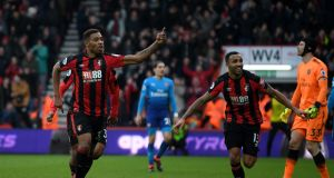 Jordon Ibe celebrates scoring  Bournemouth's winner   with team-mate Callum Wilson  during the Premier League match against  Arsenal at the Vitality Stadium. Photograph:  Mike Hewitt/Getty Images