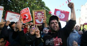 People attend demonstrations on the seventh anniversary of the toppling of president Zine El-Abidine Ben Ali, in Tunis, on Sunday. Photograph:  Amine Ben Aziza/Reuters