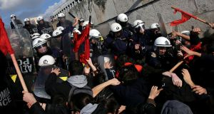 Protesters clash with riot police outside the Athens parliament building over planned government reforms, on January 12th, 2018. Photograph: Alkis Konstantinidis/Reuters