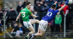 Meath's Bryan McMahon scores despite the attempted block from Paddy Fennelly of Longford. Photograph: Laszlo Geczo/Inpho