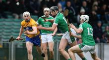 Clare's Conor Cleary under pressure from Gearoid Hegarty and Aaron Gillane of Limerick. Photograph: Cathal Noonan/Inpho
