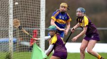 Tipperary's Sarah Fryday scores a goal despite the efforts of Wexford's Emma Kiely and Chloe Cashe. Photograph: Bryan Keane/Inpho