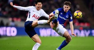 Son Heung-Min of Tottenham Hotspur leaves Jonjoe Kenny of Everton plodding through quicksand. Photograph: Justin Setterfield/Getty Images