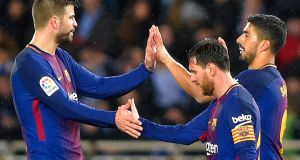 Luis Suarez celebrates his second goal with Lionel Messi Gerard Pique at the Anoeta stadium in San Sebastian. Photograph: Getty Images