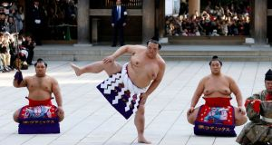 Japanese grand sumo champion Yokozuna Kisenosato performs the New Year's ring-entering rite at the annual celebration for the New Year at Meiji Shrine in Tokyo. Photograph: Toru Hanai/Reuters