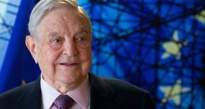 "George Soros, founder and chairman of the Open Society Foundations. He believes Russia is the source of much of the attacks against him, and that it's personal. ""Putin doesn't like me,"" he says. Photograph: Olivier Hoslet/AFP/Getty Images"