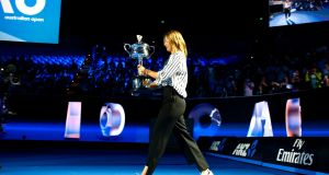 Russia's Maria Sharapova holds the Women's singles trophy during the official draw ceremony ahead of the Australian Open. Photograph: David Gray/Reuters