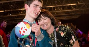 Simon Meehan with  his science teacher Karina Lyne after he was awarded top prize at the 2018 BT Young Scientist & Technology Exhibition. Photograph: Chris Bellew /Fennell Photography