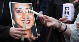 A photograph  of Savita Halappanavar at a repeal the Eighth Amendment rally in Dublin. Photograph: Getty images