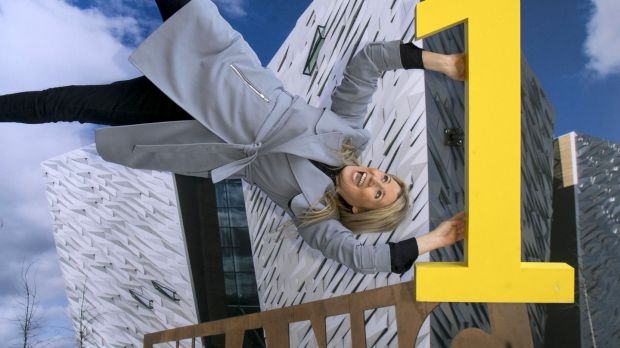 Fiona Cunningham of Tourism NI hangs on to Titanic Belfast for dear life at a display in Dublin.
