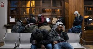 Exhausted migrants in the waiting hall of the train station in Bardonecchia, Italy. Photograph: AFP/Getty Images