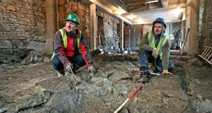 Archaeologist Frank Coyne (left) and     sections the   13th century stone castle built for the de Burgh family on what is now Quay Street, Galway.  Photograph: Joe O'Shaughnessy