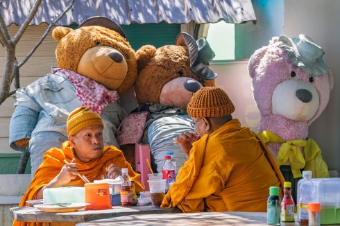GOLDILOCKS AND THE THREE BEARS: Monks eat their breakfast at a small restaurant on top of a mountain in Phetchabun Province, about 400km north of Bangkok. The monks were wearing orange knitted hats, in addition to the traditional orange robes due to the cooler air at this altitude, which is about 1,660m above sea level. Photograph: John Greene, Carrigallen