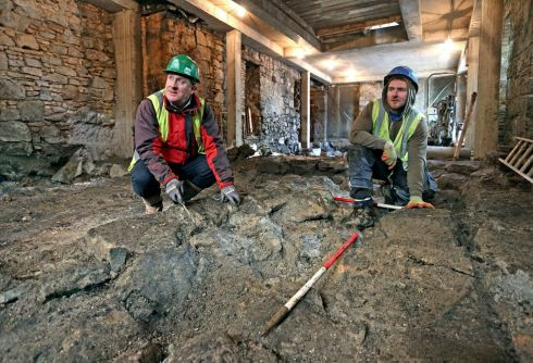 HIDDEN TREASURE: Archaeologist Frank Coyne working on a section of Galway's oldest building, a 13th-century stone castle built for the de Burgh family on what is now Quay Street, which were unearthed during restoration of a 15th-century manor for a retail development. Photograph: Joe O'Shaughnessy