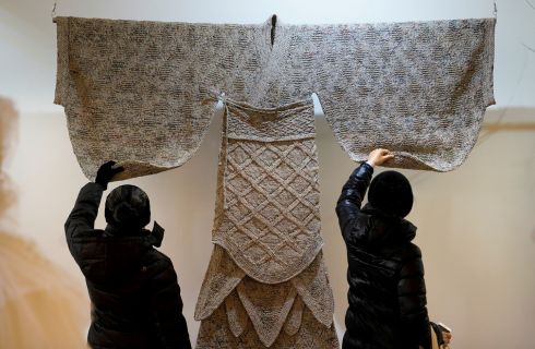RECYCLING: Visitors check the details of a creation of a Han-dynasty (202 BC-AD 220) costume by designer Wang Lei, which is made of old newspapers, at the third Beijing International in Style Expo in China. Photograph: Jason Lee/Reuters