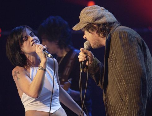 Dolores O'Riordan joins Italian singer Zucchero onstage during a benefit show in aid of the UNHCR refugee fund, at the Royal Albert Hall, London, in May 2004. Photograph: Yui Mok/PA Wire