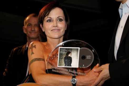 Dolores O'Riordan poses with her European Border Breakers Award during Midem, in Cannes, France, in January 2008. Photograph: Gilbert Tourte/Reuters