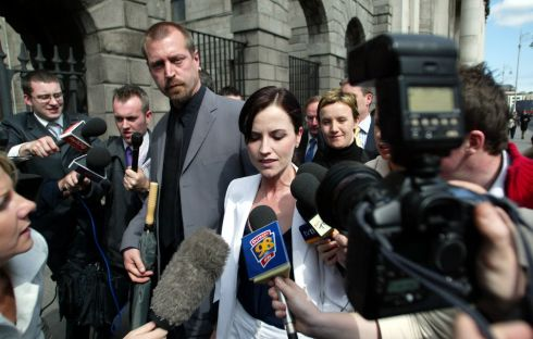 Dolores O'Riordan and her then husband Don Burton leave the High Court in Dublin after winning an action taken against them by their former nanny Joy Fahy. Photograph: Collins