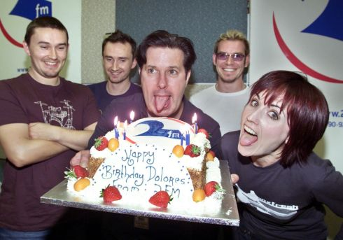 Dolores O'Riordan is presented with a birthday cake by 2fm DJ Gerry Ryan, at RTÉ studios. Photograph: Colin Keegan/Collins