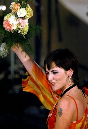 Dolores O'Riordan waves after a performance in San Remo's Ariston Theatre, in Italy, in March 2002. Photograph: Claudio Papi/Reuters