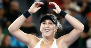 Belinda Bencic celebrates her victory over Venus Williams in the Australian Open at the  Rod Laver Arena, Melbourne. Photograph: Thomas Peter/Reuters
