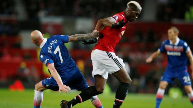 Stoke City's Stephen Ireland challenges Manchester United's Paul Pogba during the Premier League game at Old Trafford. Photograph: Andrew Yates/Reuters
