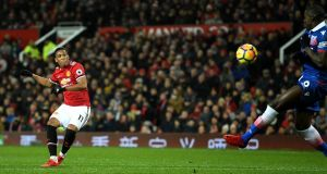 Anthony Martial scores  Manchester United's  second goal during the Premier League match against Stoke City at Old Trafford. Photograph: Gareth Copley/Getty Images