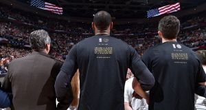 LeBron James of the Cleveland Cavaliers stands for the National Anthem before the game against the Golden State Warriors. Photograph: Getty Images