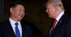 Chinese president Xi Jinping and his US counterpart Donald Trump: phone call comes at a time when there are tentative signs of rapprochement between the two Koreas. Photograph: Carlos Barria/Reuters