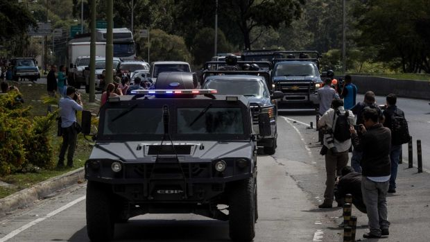 Members of the Bolivarian Armed Forces head to the location of an operation against a rebel group in the El Junquito neighbourhood of Caracas, Venezuela, on Monday. Photograph: Miguel Gutierrez/EPA