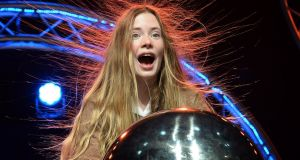 Margot Moore, a first-year student from Loreto College, Foxrock, in Dublin, has a hair-raising experience at the BT Young Scientist and Technology Exhibition at the RDS. Photograph: Eric Luke