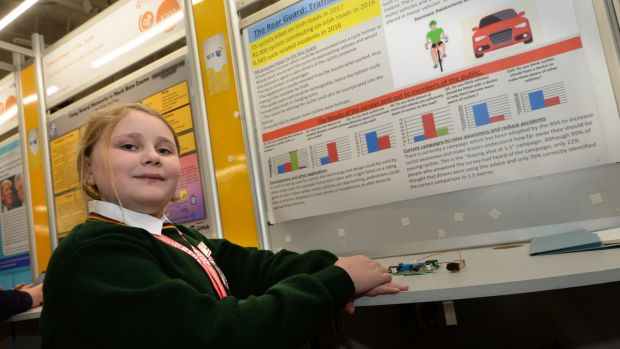 Lily Eyers, a first-year student at Killorglin Community College in Co Kerry, with her project Rear Guard, at the BT Young Scientist and Technology exhibition, in the RDS. Photograph: Dara Mac Dónaill